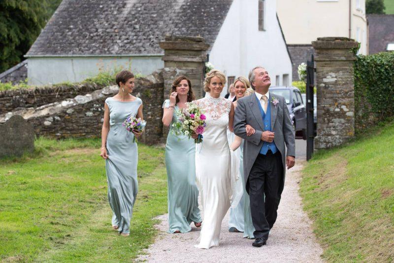 bride bridesmaids father church arrival