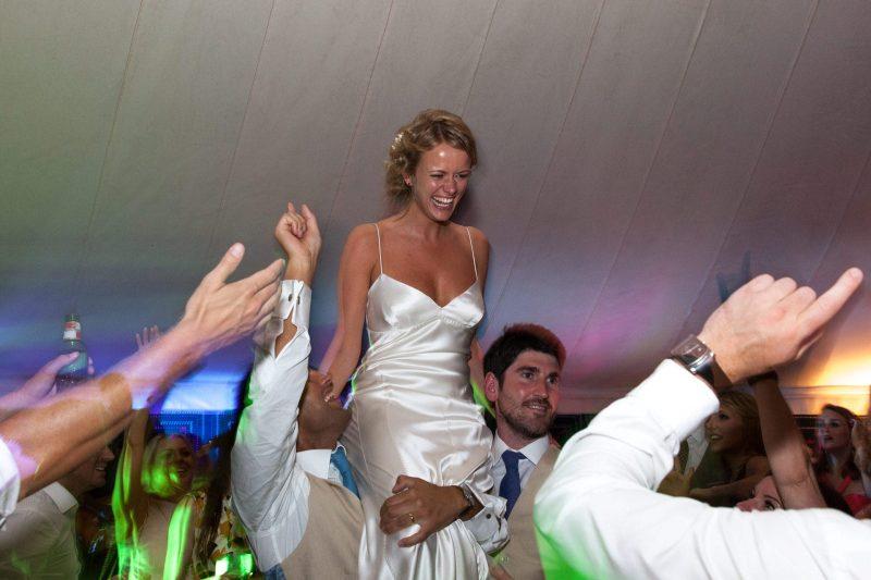 bride on shoulders devon wedding
