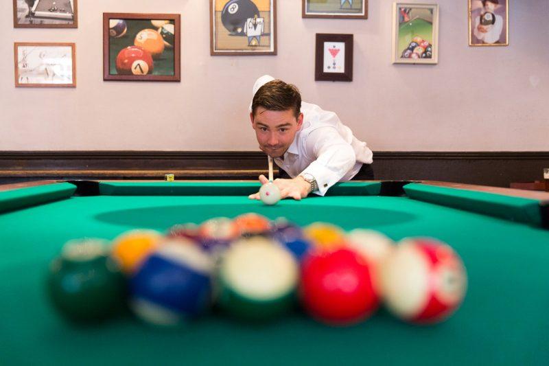 pre-wedding groom pub playing pool