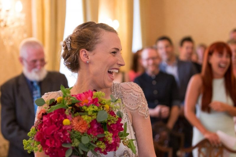 laughing bride during wedding ceremony