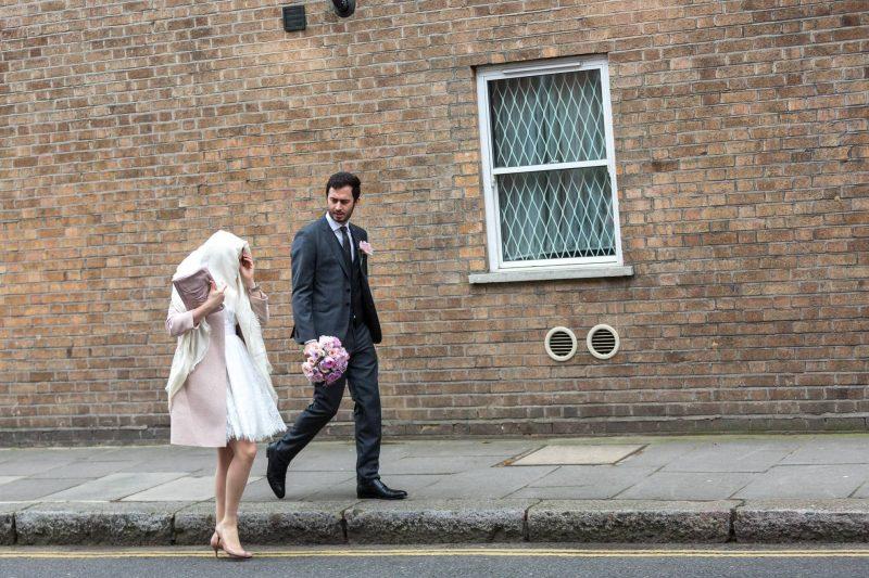 london bride groom walking in rain