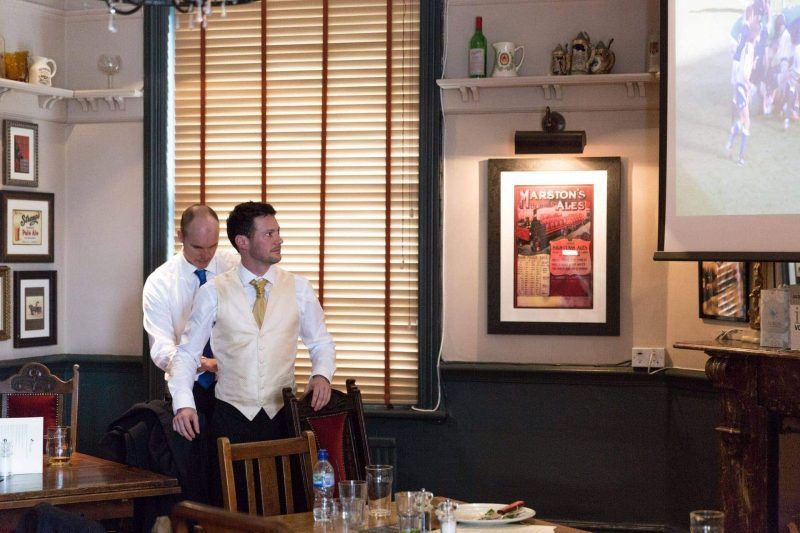 groom prep for wedding in pub