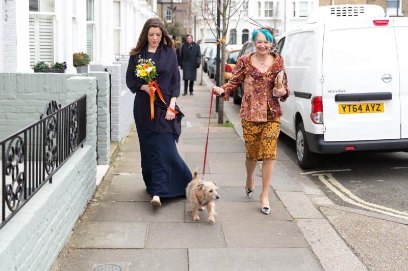 mother of bride walking dog