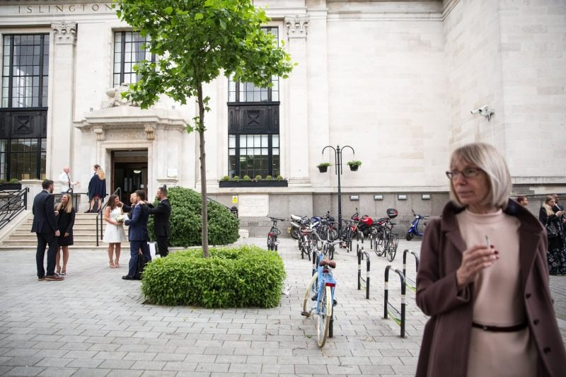 london wedding guests gather with bride
