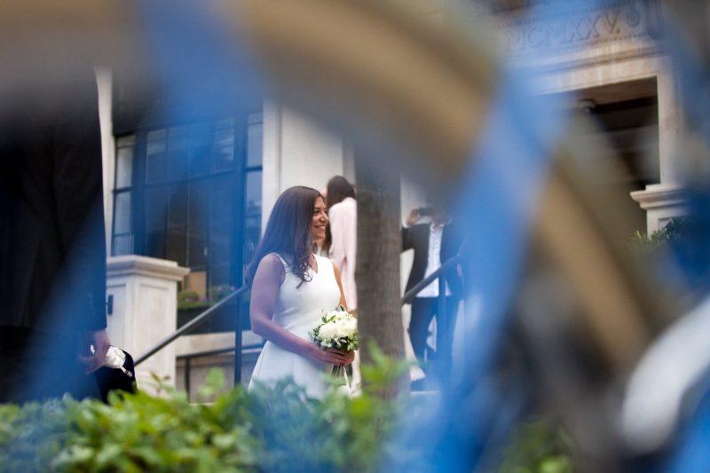 bride outside registry office before london wedding