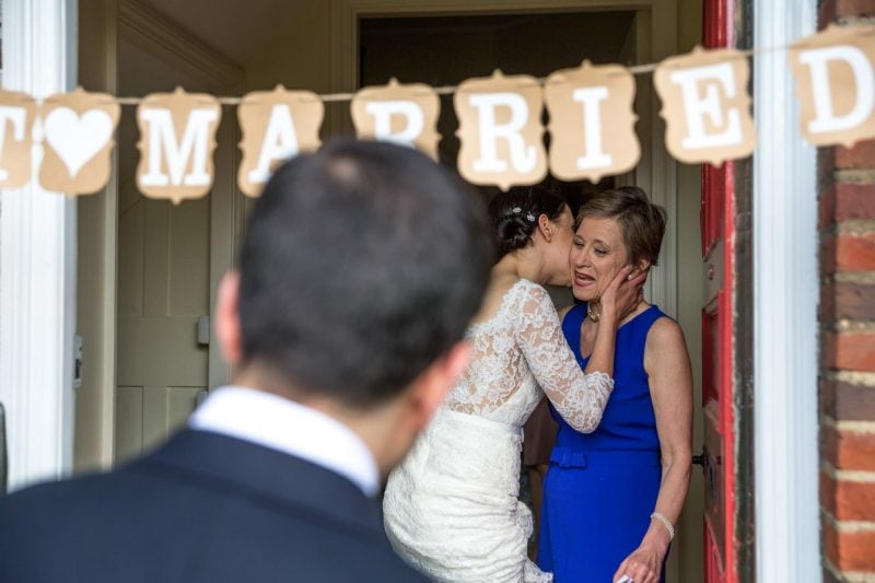 just married bride mother kiss