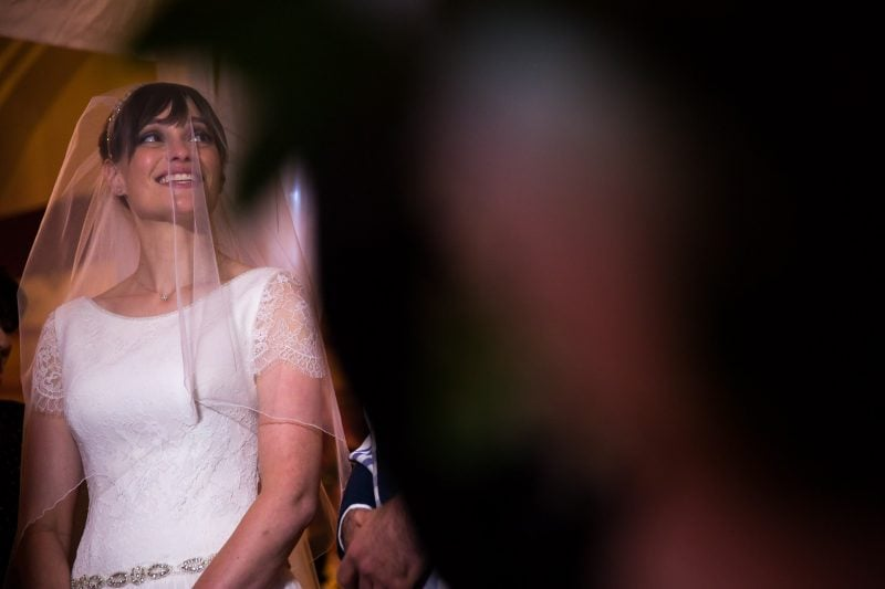 happy bride during wedding ceremony