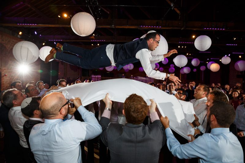 flying jewish groom tablecloth photographer