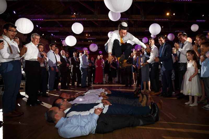 groomsmen jewish wedding jumping