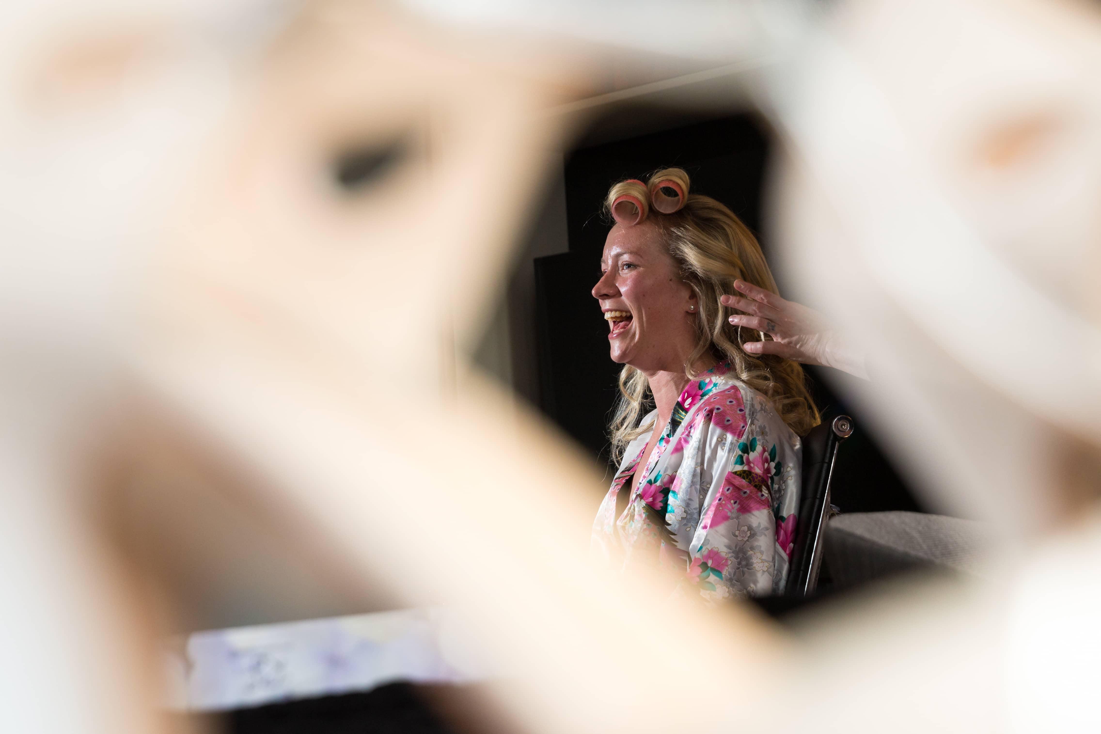 smiling bride hair photographer