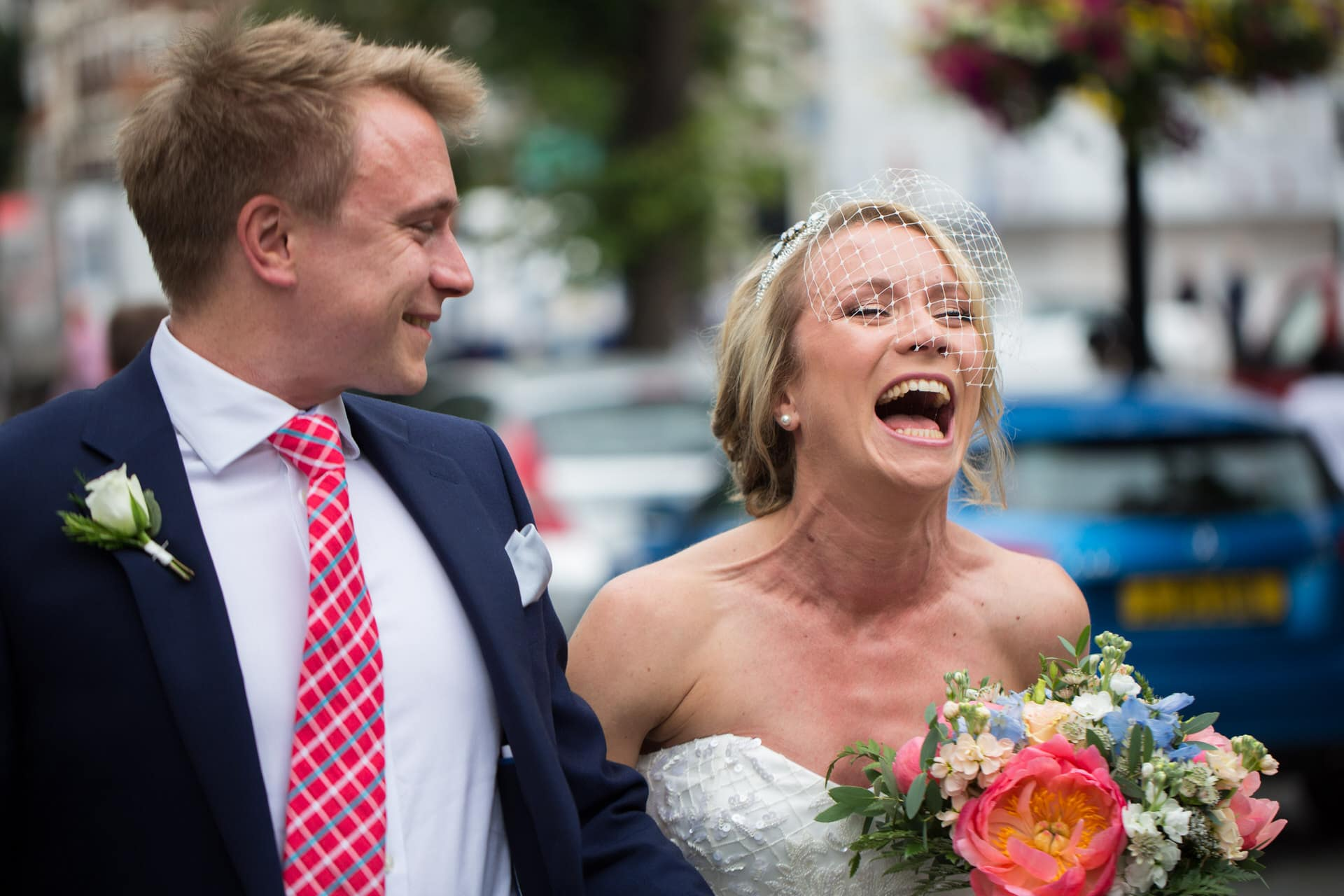laughing bride and brother