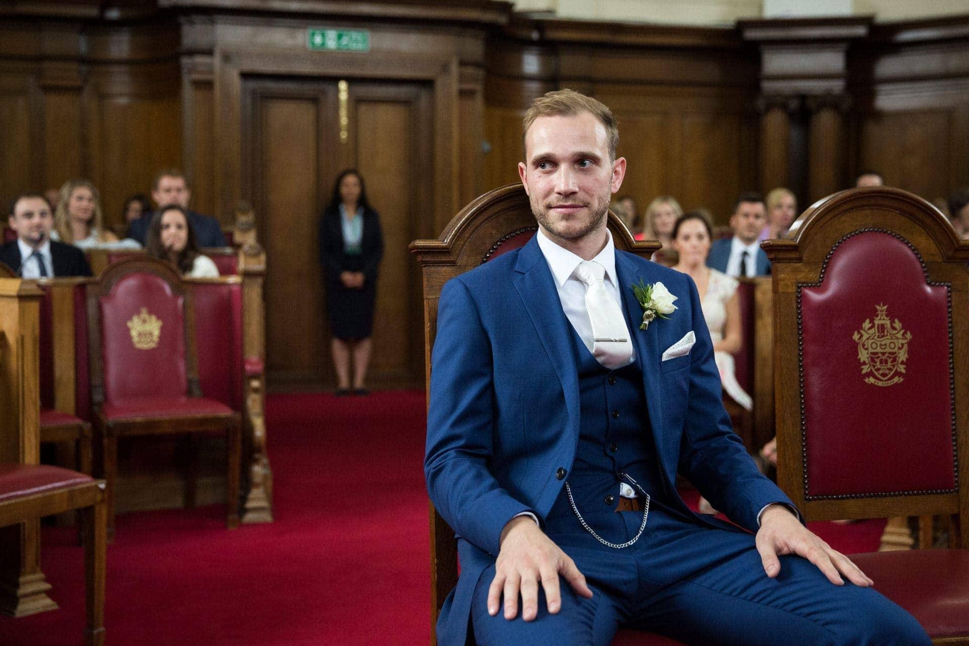 wedding groom awaits bride