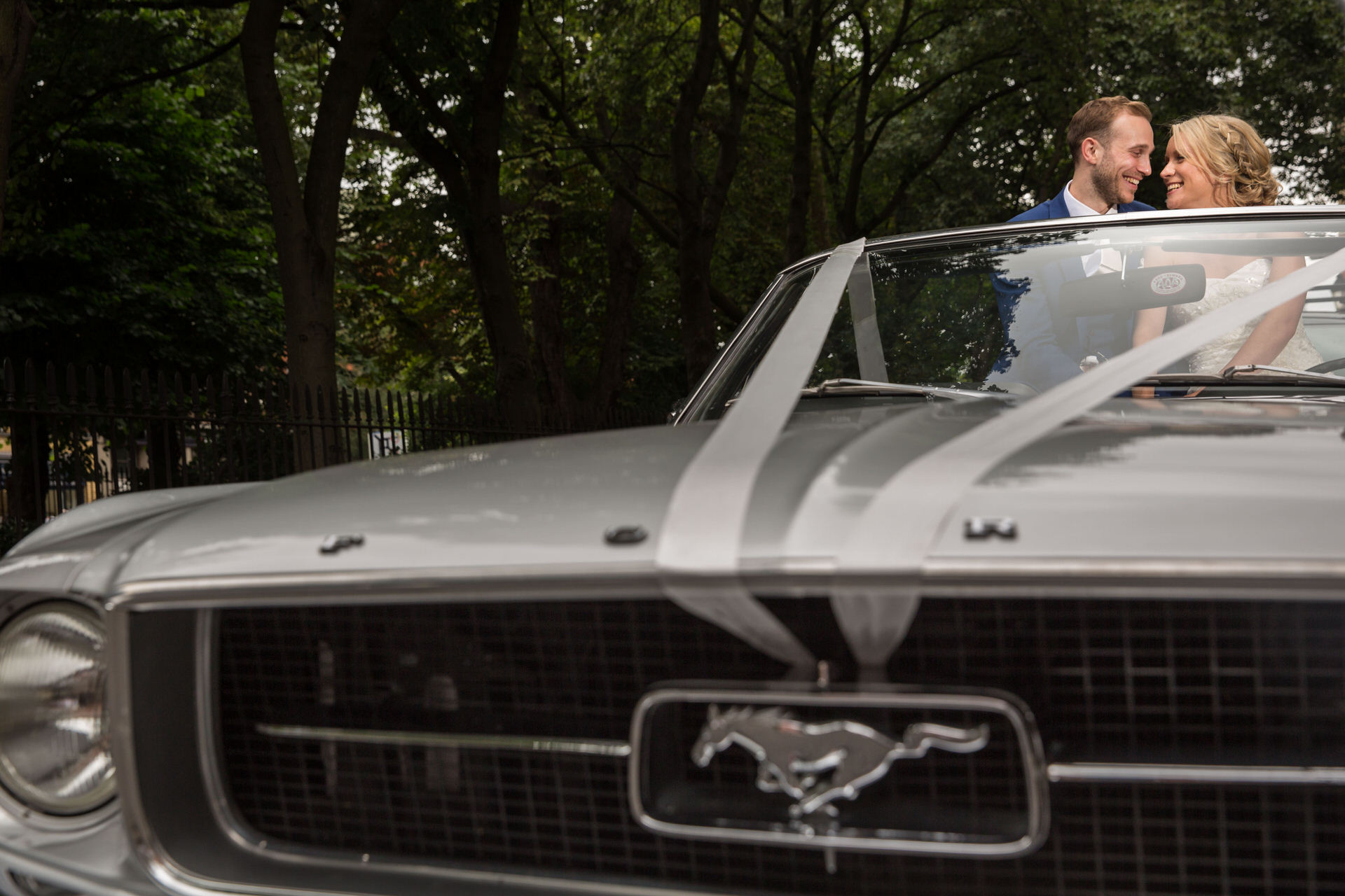 bride and groom mustang wedding car