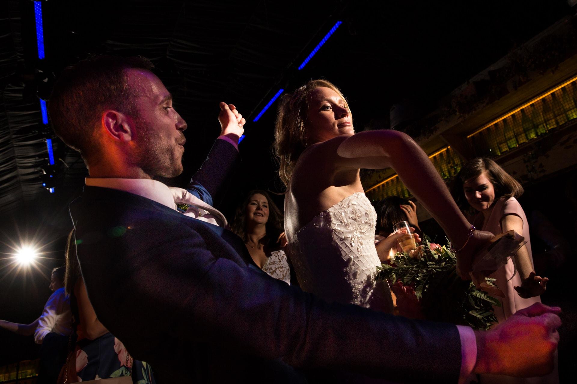 dancing bride and groom photographer