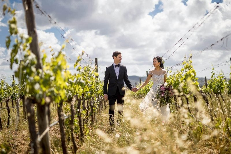 bride and groom in tuscan vineyard