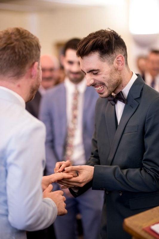 same-sex wedding photographer ring exchange