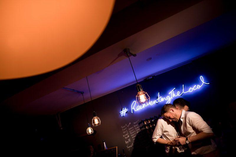 grooms hugging london wedding