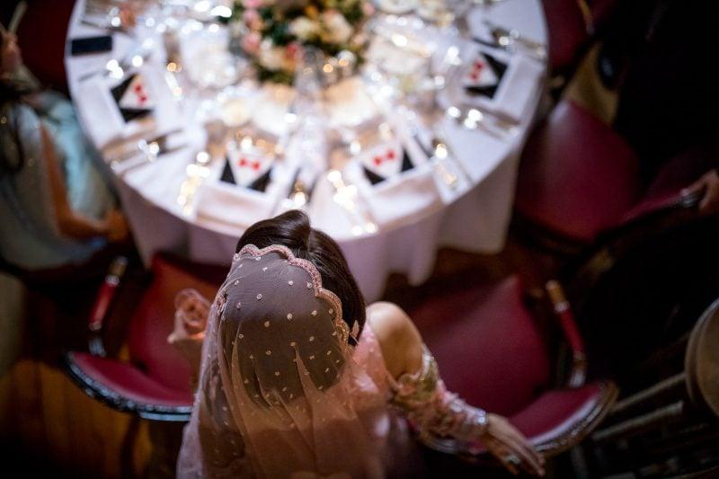 bride sitting down for dinner