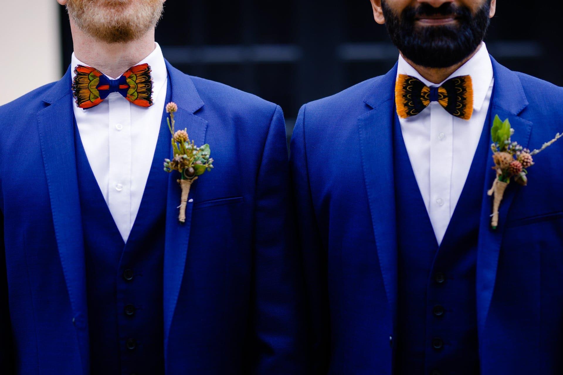 two grooms wearing bow-ties