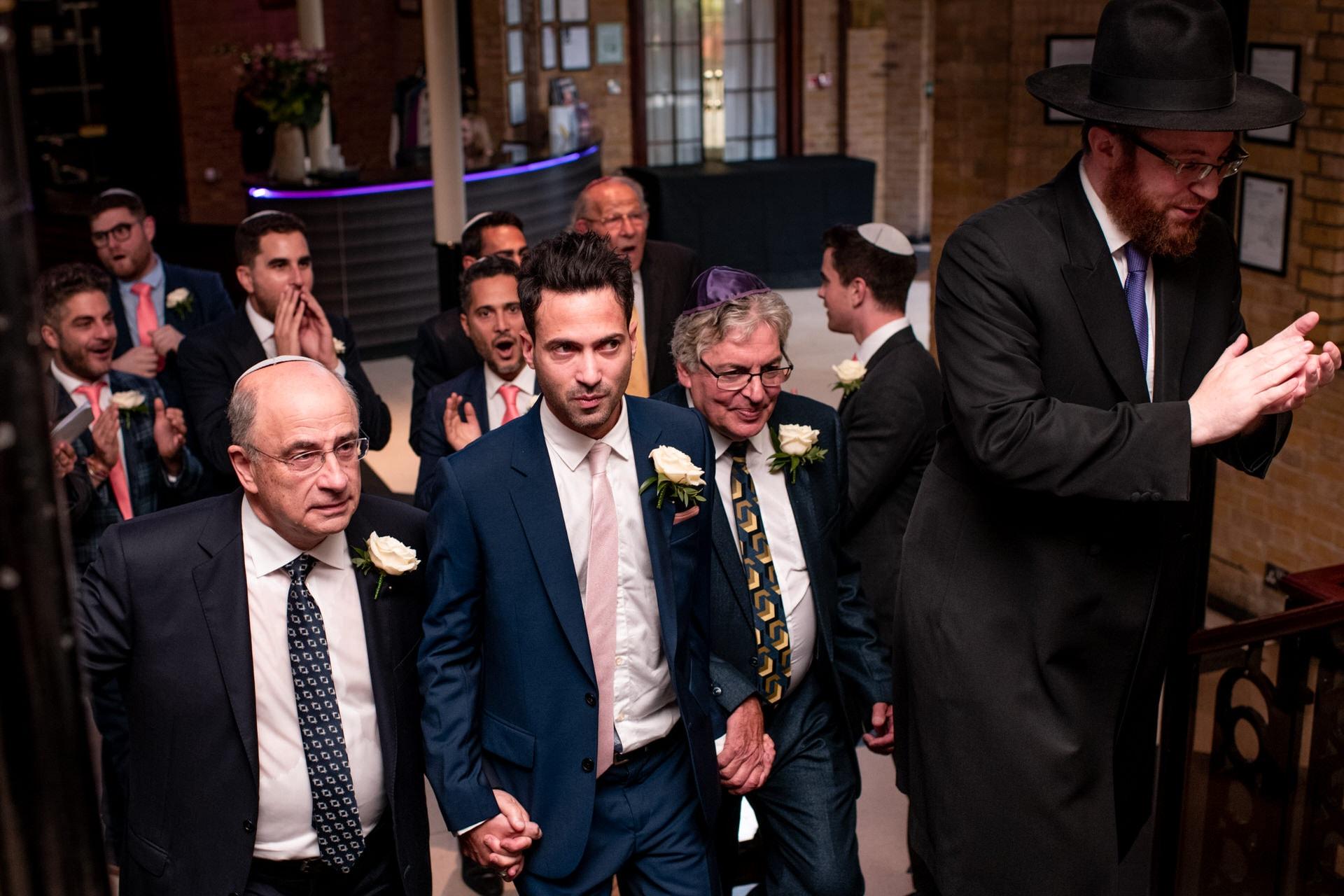 groom groomsmen rabbi