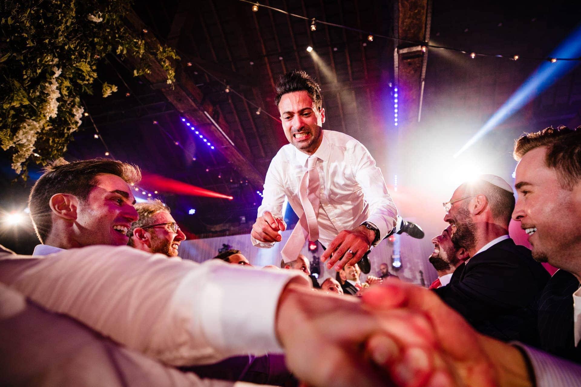 flying groom jewish wedding
