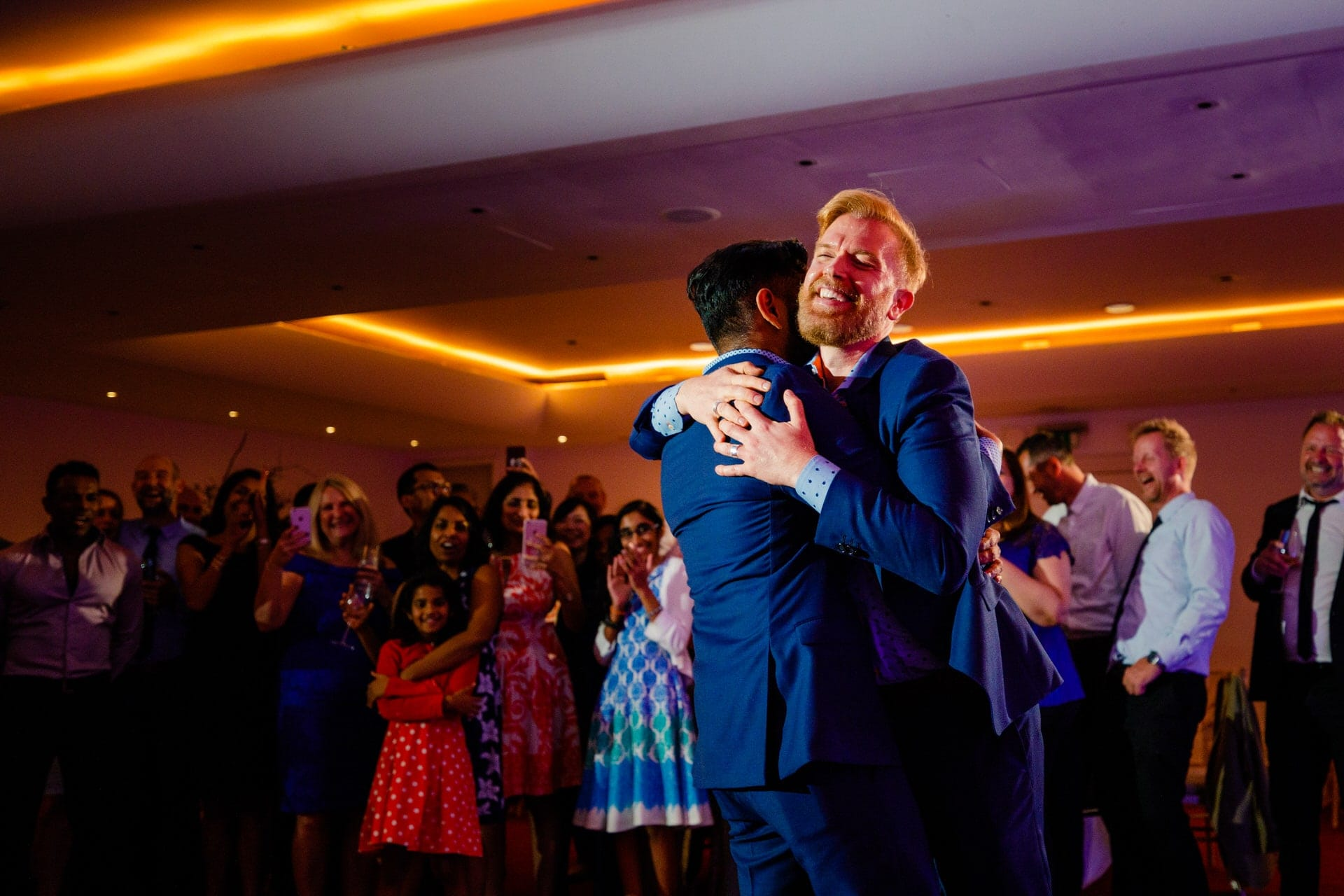 two grooms hug london wedding