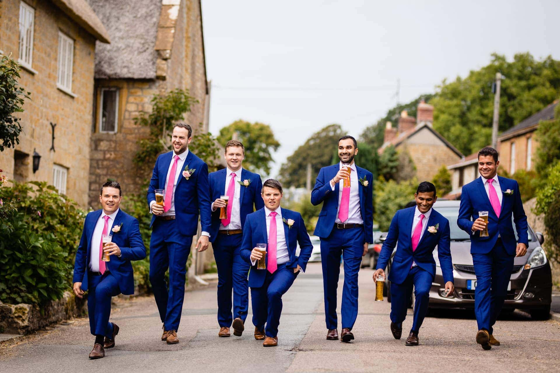 groom beer groomsmen lunging wedding