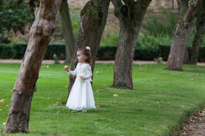 wedding flower girl with apple