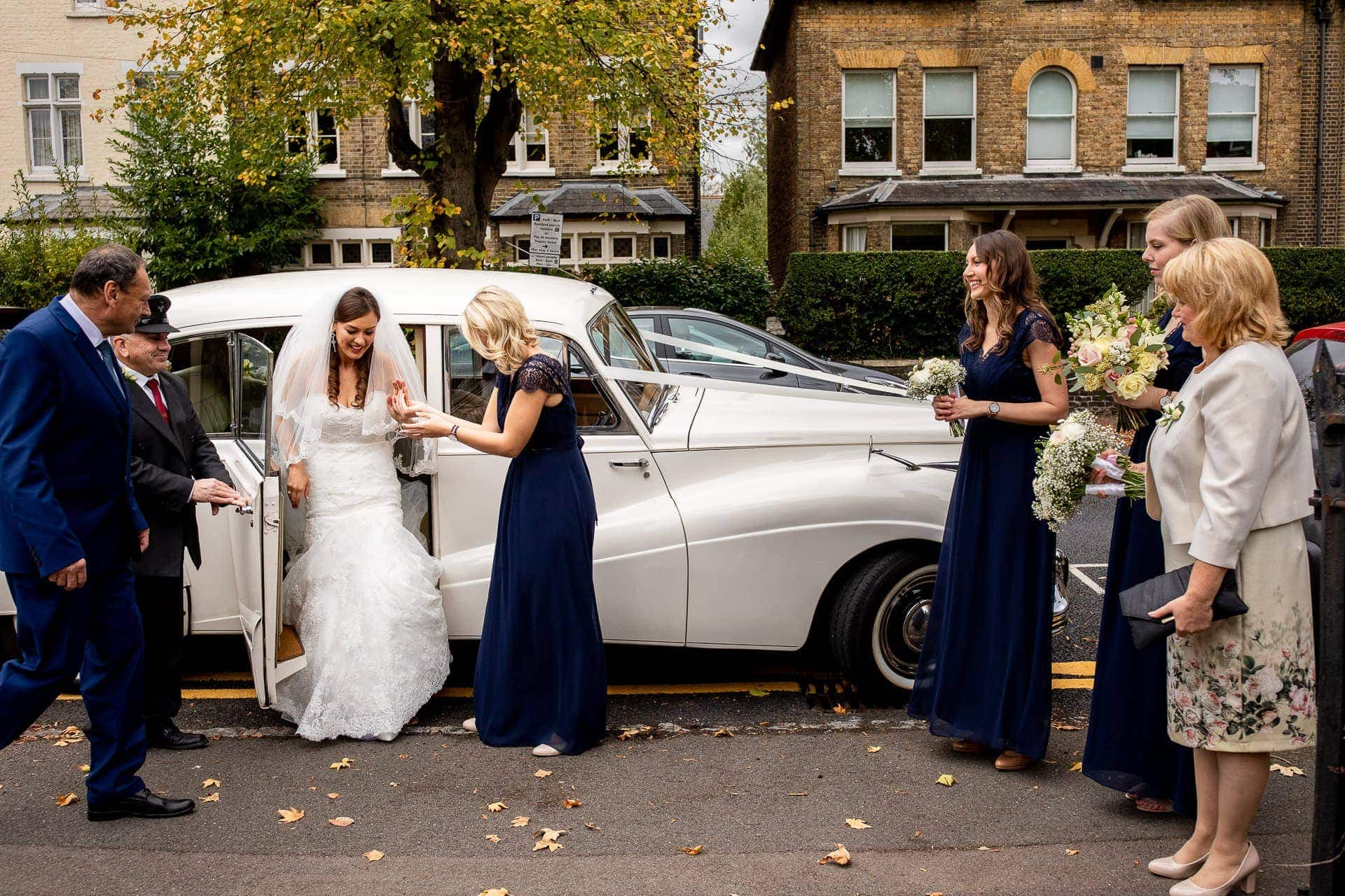 bride arriving for church wedding from car