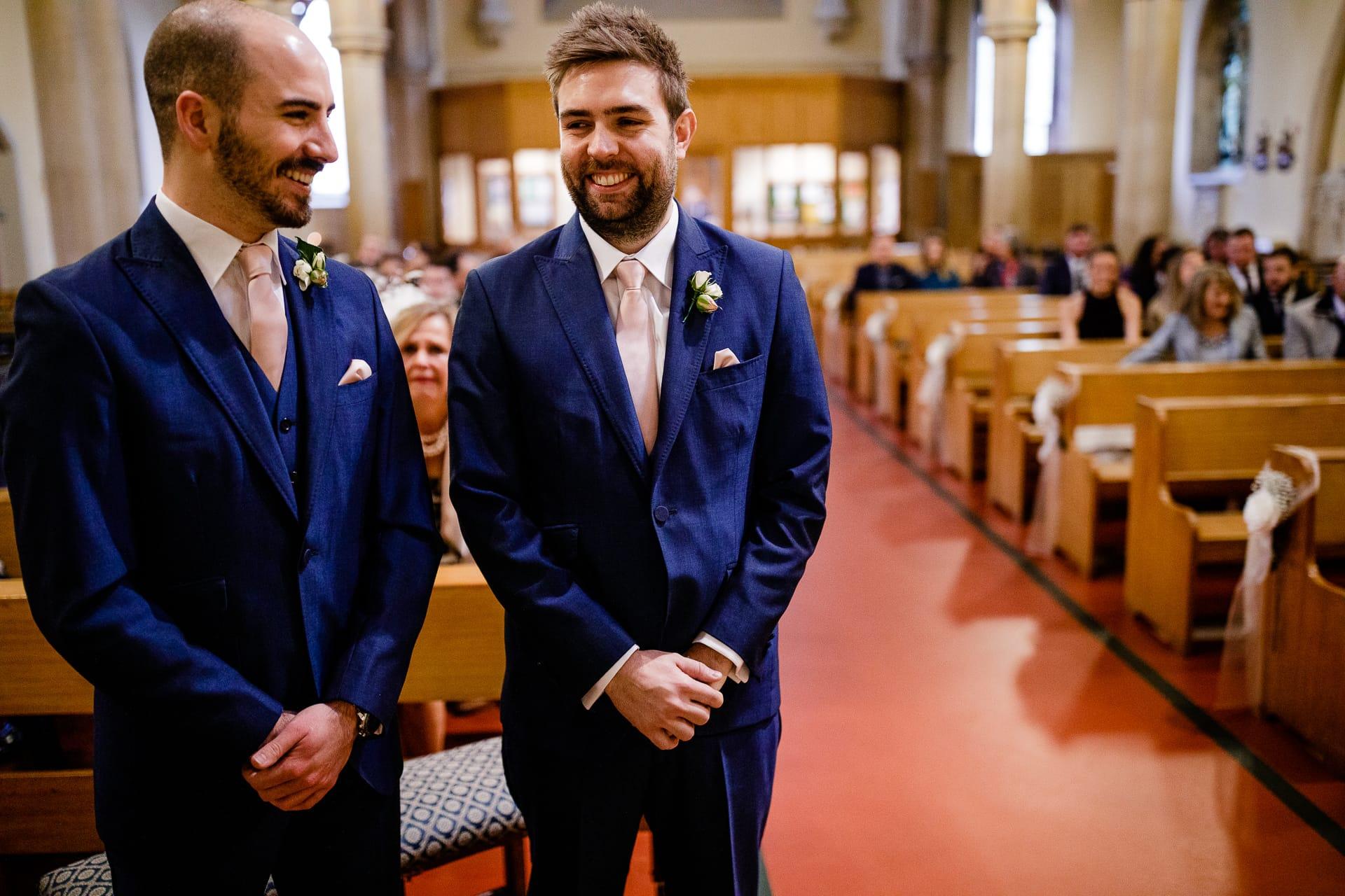 groom and best man waiting church wedding