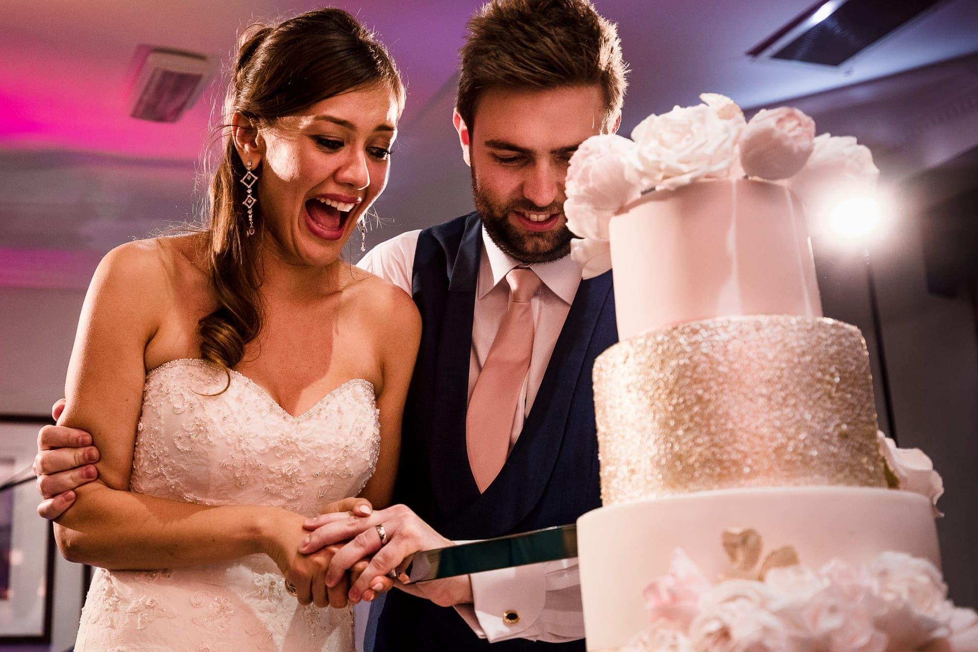 happy cake cutting photographer