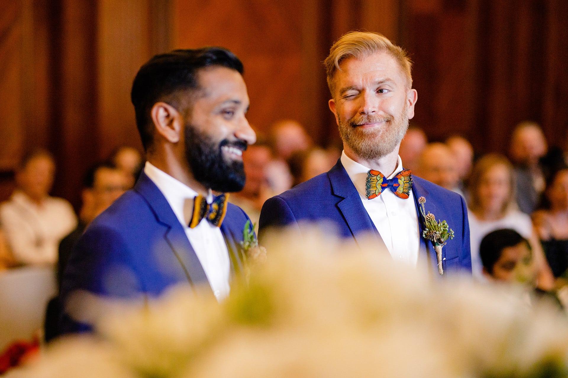 winking groom to groom